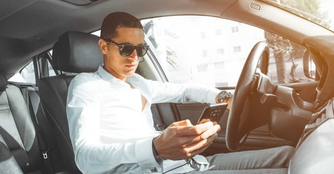 A driver checking his cell phone